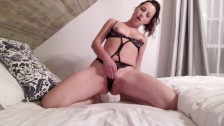 Sexy brunette ride a dildo in her bed