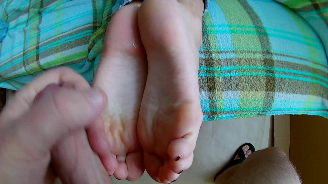 Super Load On Soles. Gorgeous Girl Gives A Hot Footjob In Jeans