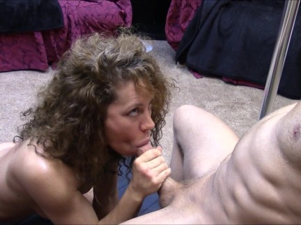 Brunette babe sucks and strokes a cock until she makes it cum