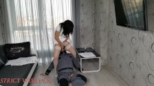 Strict Wife Mia tells her history. Slave is licking pussy and feet.