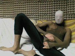 YOUNG GUY IN TAN PANTYHOSE ENCASEMENT AND SPANDEX LEGGINGS MASTURBATING