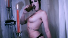 Vampire Goth Plays with Candles
