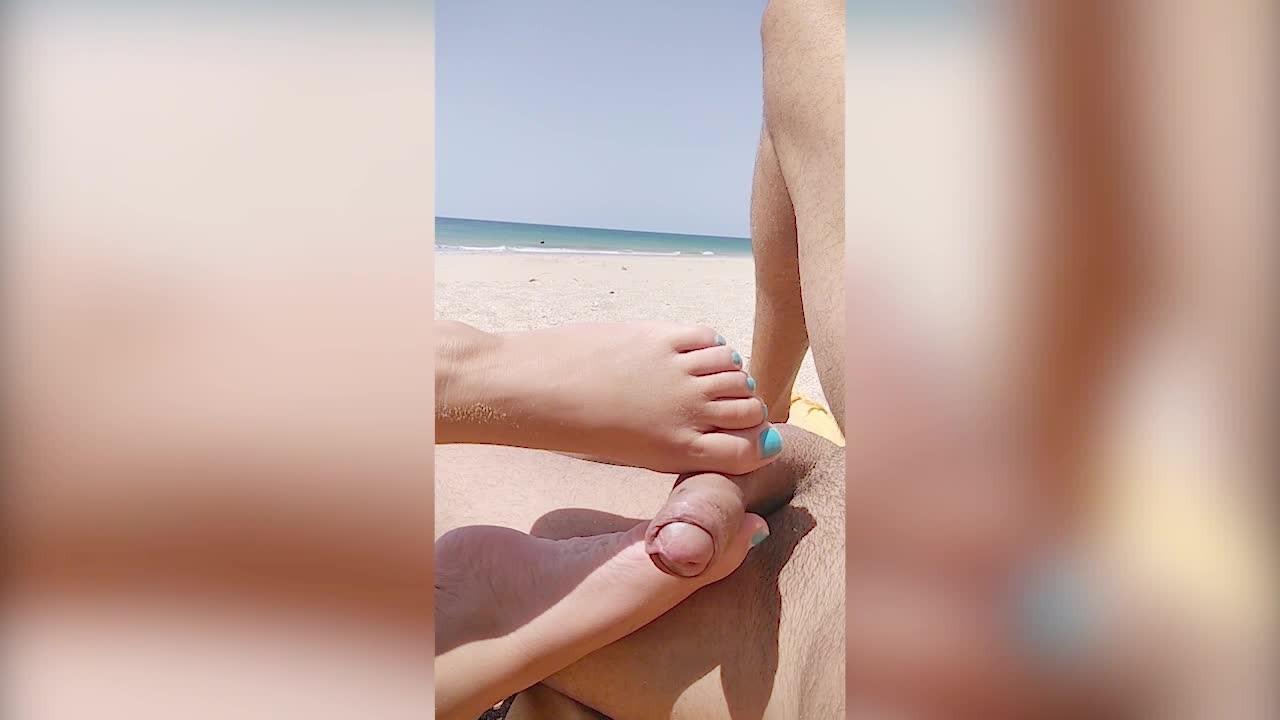 Nude public beach. Risky footjob and handjob by strangers. Almost caught