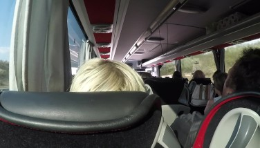 The naked blonde masturbates in a public bus.