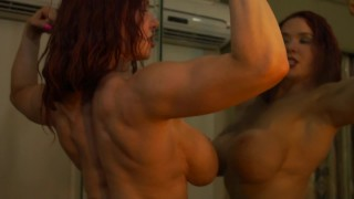 Busty Ginger Flexes Her Big Muscles in the Mirror