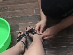 Femdome slave washes feet mistress
