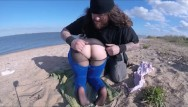 About vintage clothing Gymnast girl is groped and has her clothes tear on beach
