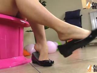 Barefoot girl shoeplay in shiny ballet flats
