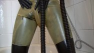 Girls in rubber porn Young latex fetish girl fully rubberized with pisspants and gasmask