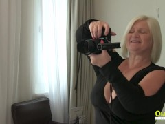 Mature lady with huge natural breasts in action
