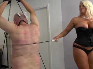 Then she fix him on a chair, tortures his balls and nipples and spank him again hard.