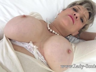 Big titty blonde mature Lady Sonia loves to tease!