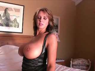 Feel horny with Brandy Robbins showcasing her enormous boobs